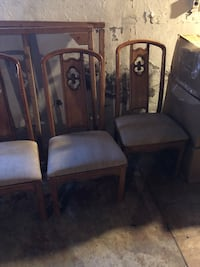 three brown wooden framed gray padded chairs 183 mi