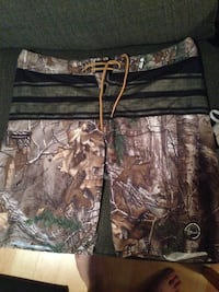 brown and green real tree print board shorts