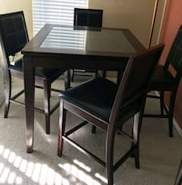 rectangular brown wooden table with four chairs dining set Burnaby, V5G 3K4