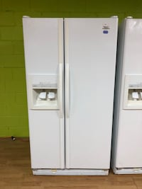 Whirlpool white side by side refrigerator  47 km