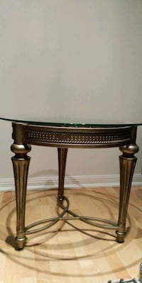 Round coffee table or multi-purpose table. Tempered beveled glass top. Toronto, M5V 1B5