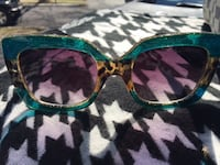 green and black framed sunglasses Oxon Hill