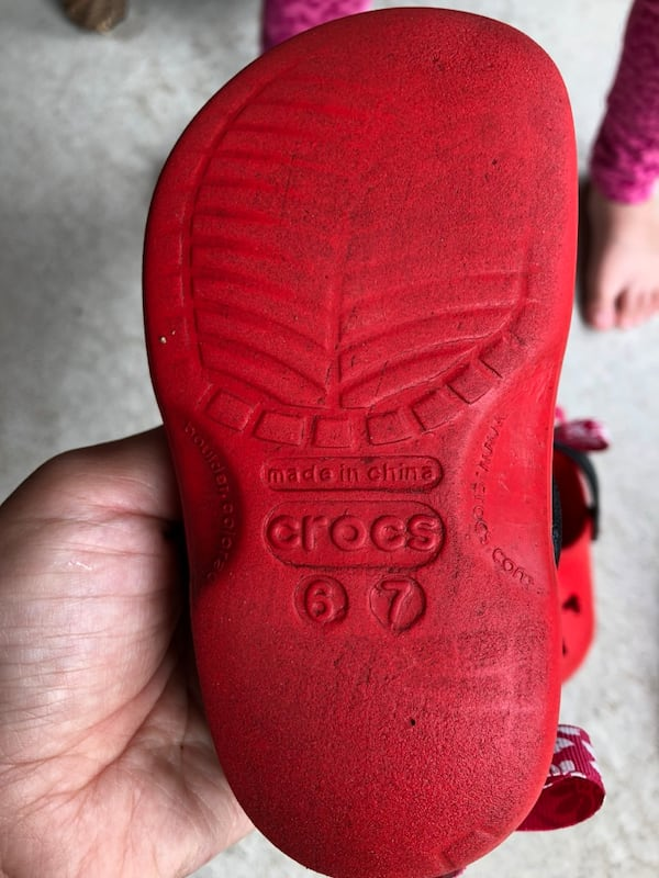 pair of red Crocs rubber clogs c5bcc4a6-0350-46db-add8-6c5eb4c95175