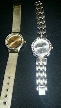 two round silver analog watches with link bracelets Winnipeg, R2K