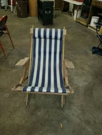 blue and white wooden armchair 64 km