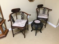 Two brown Oriental wooden armchairs With cushions and table