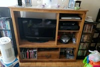 brown wooden TV hutch and flat screen TV 532 km