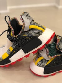 Exclusive Pharell SOLARHU Human races size 10 Beaconsfield, H9W 2L9
