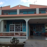 teal and white concrete 2-storey house