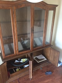 Brown wooden framed glass display cabinet Houston, 77077