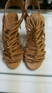 pair of brown leather gladiator sandals Woodbridge, 22193
