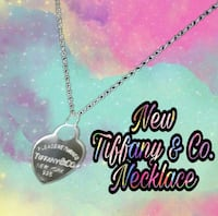 silver-colored necklace with text overlay Tucson