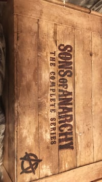 brown wooden Sons of Anarchy box