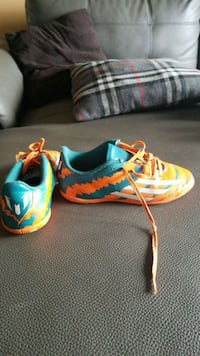 pair of green-and-orange messi soccer shoes   Toronto, M1S 0G3