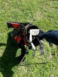 black and red golf bag with golf clubs Nashville, 37115
