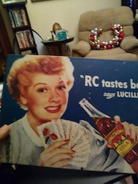Tin sign lucy with R C