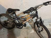 black Huffy hardtail mountain bike