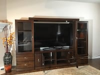 Flat screen television with brown wooden tv hutch Vancouver, V6H 1Z8