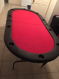 Professional red felt poker table with individual cup holders....seats 10 Surrey, V3T 4M4
