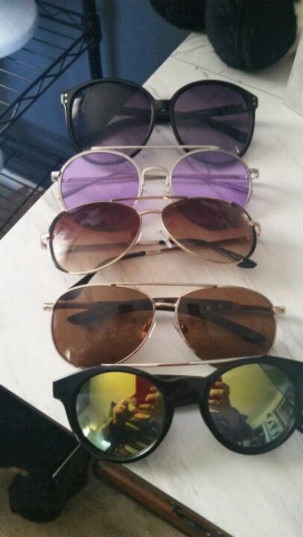 5 pair of sunglasses