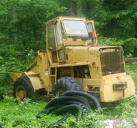 yellow and black front loader Castleton, 22716