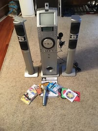 The Singing Machine Karaoke set (includes 2 microphones and 12 karaoke DVDs)