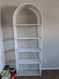 White wicker book shelf