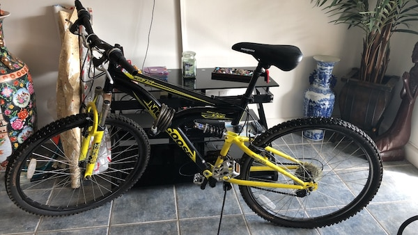 5ec490673e2 Used Black and yellow mongoose full-suspension mountain bike for ...