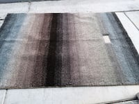 5x8 ft new rug with square missing.Easy to fill In w matching yarns.  Las Vegas, 89145
