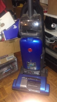 Blue and black hoover upright vacuum cleaner Dorval, H9S 3H7