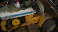 yellow and white Cub cadet ride on mower Remington, 22734