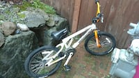 white and red Mongoose BMX bike