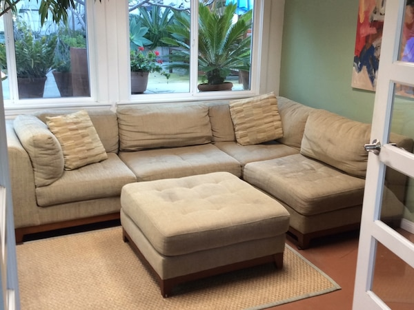 Brown fabric sectional sofa with ottoman