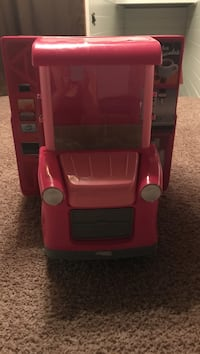 Doll ice cream truck, only a year old..in excellent condition and comes with food accessories