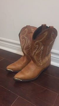 Pair of brown leather cowboy boots 538 km