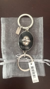 Silver-colored and black coach keychain Worcester