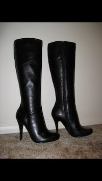Pair of black leather heeled boots Guelph, N1E 6E9