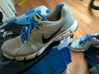 pair of gray-and-blue Nike running shoes San Antonio, 78225