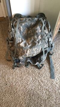 brown and gray digital camouflage tactical backpack