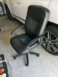 black leather office rolling armchair Tampa, 33625