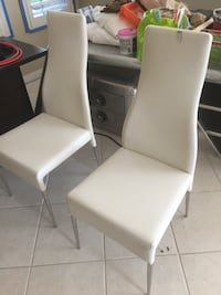 white leather padded armless chair