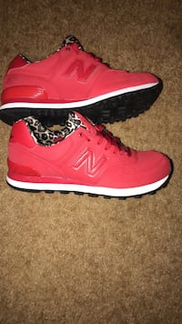 Pair of red New Balance running shoes, Women's size 9. Huber Heights, 45424