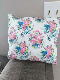 white, pink, and green floral throw pillow