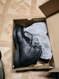 pair of black leather work boots 415 mi
