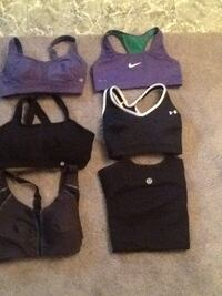 women's two purple and four black sports bra's