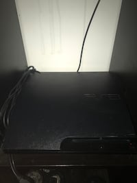 Black sony ps3 slim console+cords, one controller and 24 games