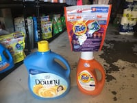 two Tide detergent bottles and two Tide detergent bottles Palmdale, 93550