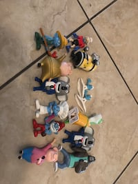 Assorted plastic toy collection with box