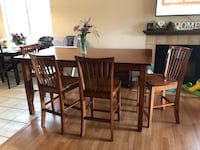 Tall dining table with 4 chairs good condition delivery available in town  Bakersfield, 93313