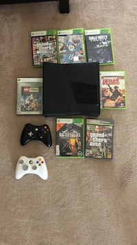 Black Xbox 360 console with controller and game cases West Chicago, 60185